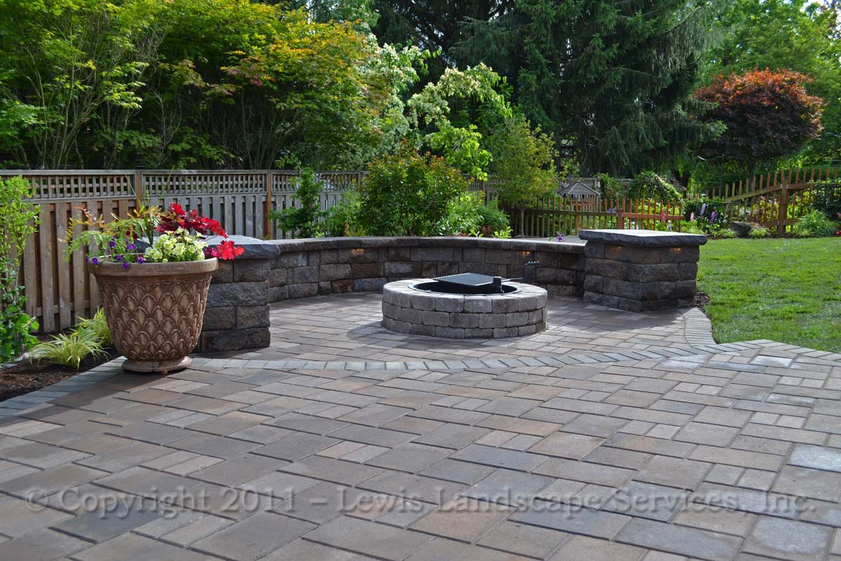 Lower Paver Patio Area with Seat Wall & Wood Fire Pit