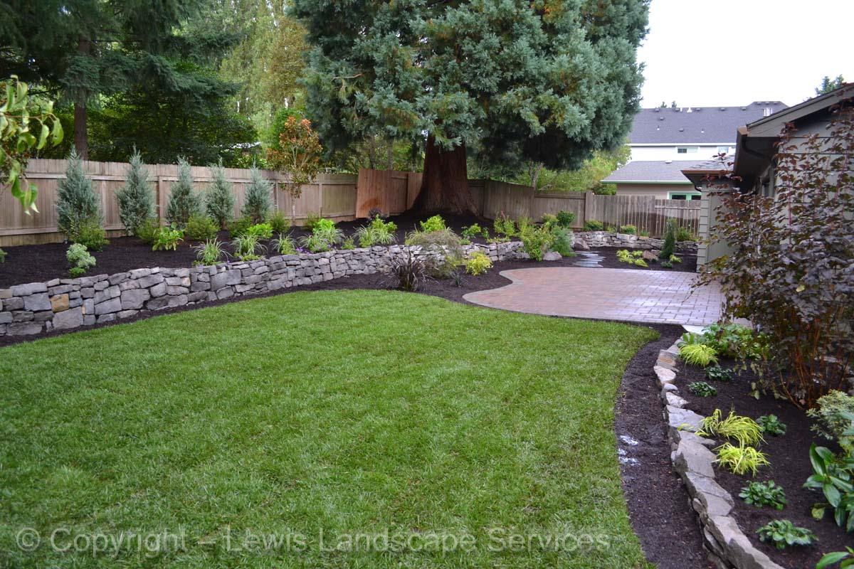 Paver Patio, Rock Walls, Planting, New Sod Lawn