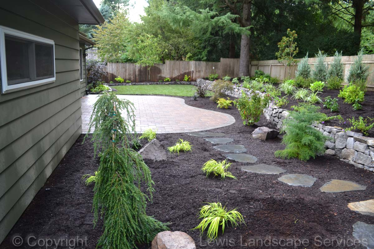 Paver Patio, Rock Walls, Planting, New Sod Lawn