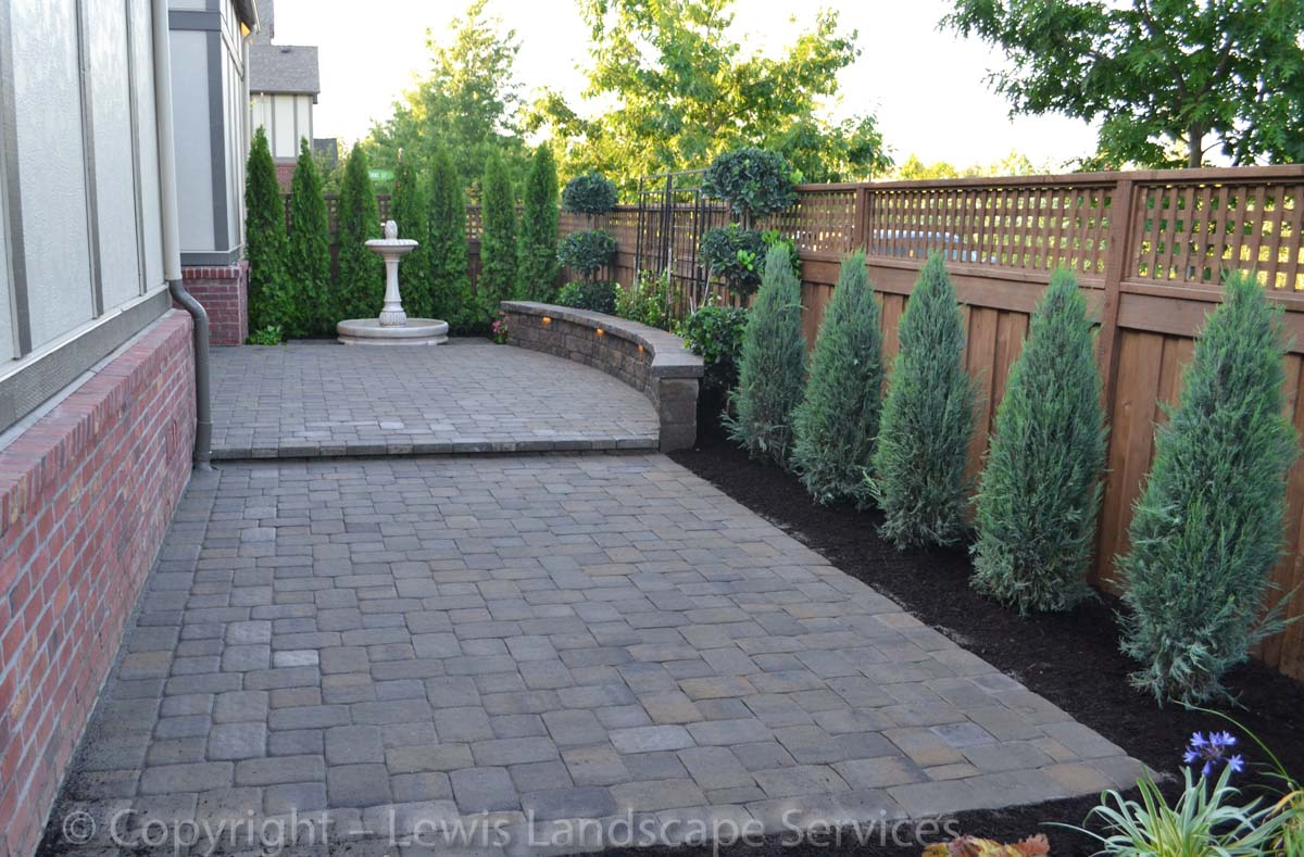 Paver Patio, Seat Wall with Lighting, New Plants & Trees