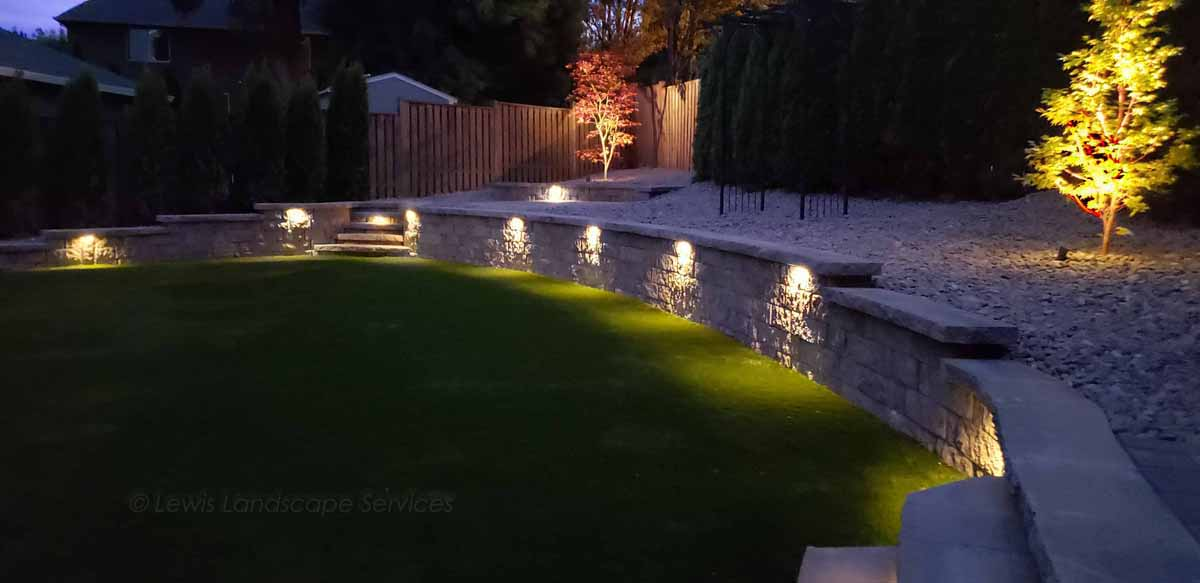 Lighting Built Into Stone Retaining Wall with Landscape Lighting at a Job in Beaverton