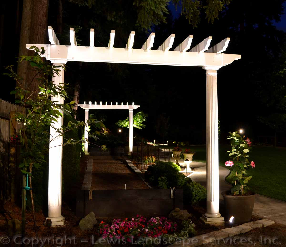 Low-Voltage Accent Lighting on Arbors at a Landscape Job We Did in Lake Oswego, Oregon