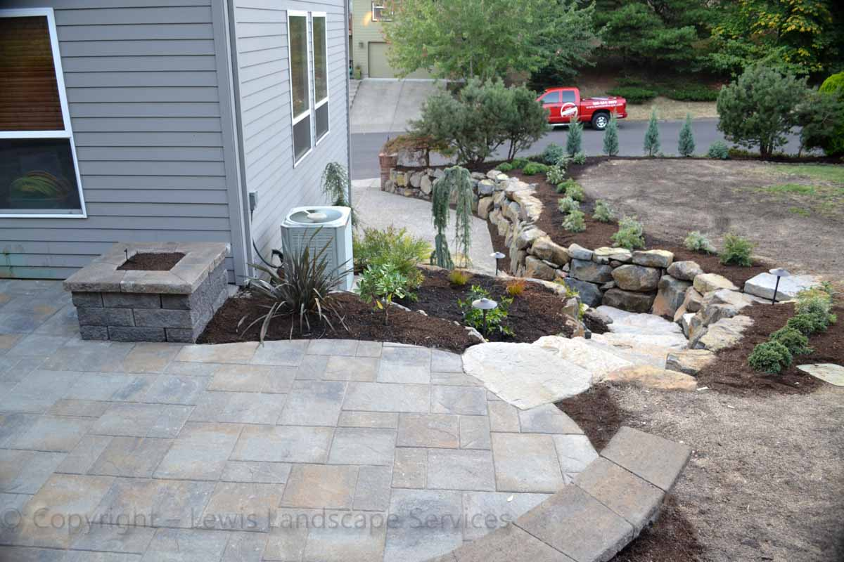 Edge of Paver Patio, Raised Planter, Rock Walls and Steps We Installed