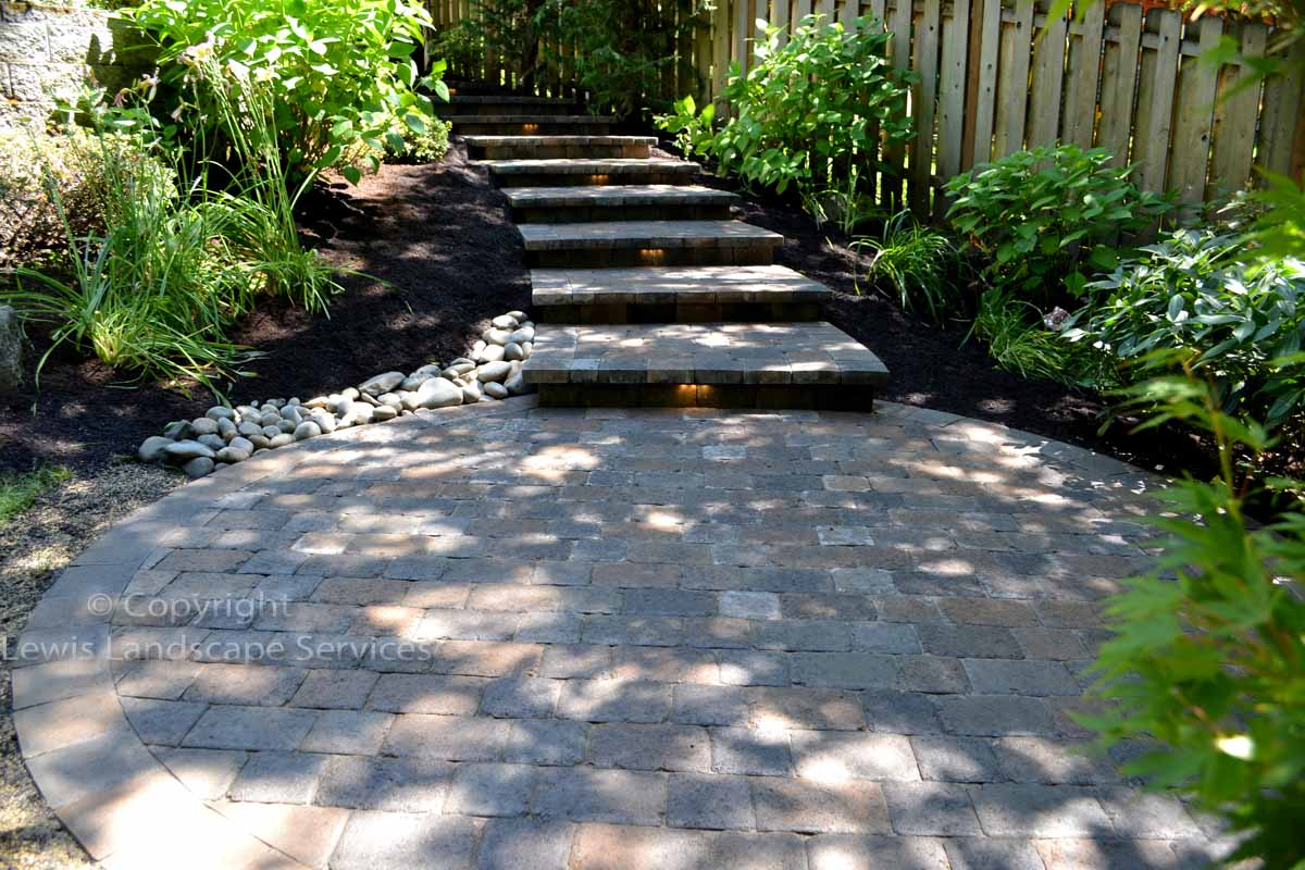 Custom Built Paver Steps Down to Paver Patio w/ Built-in Lighting