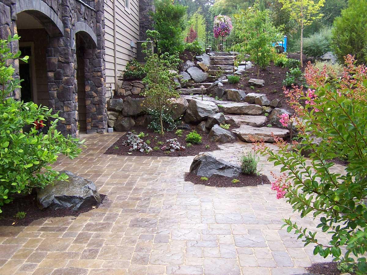 Paver Patio, Rock Slab Steps, Surrounding Landscaping & Rock Accents