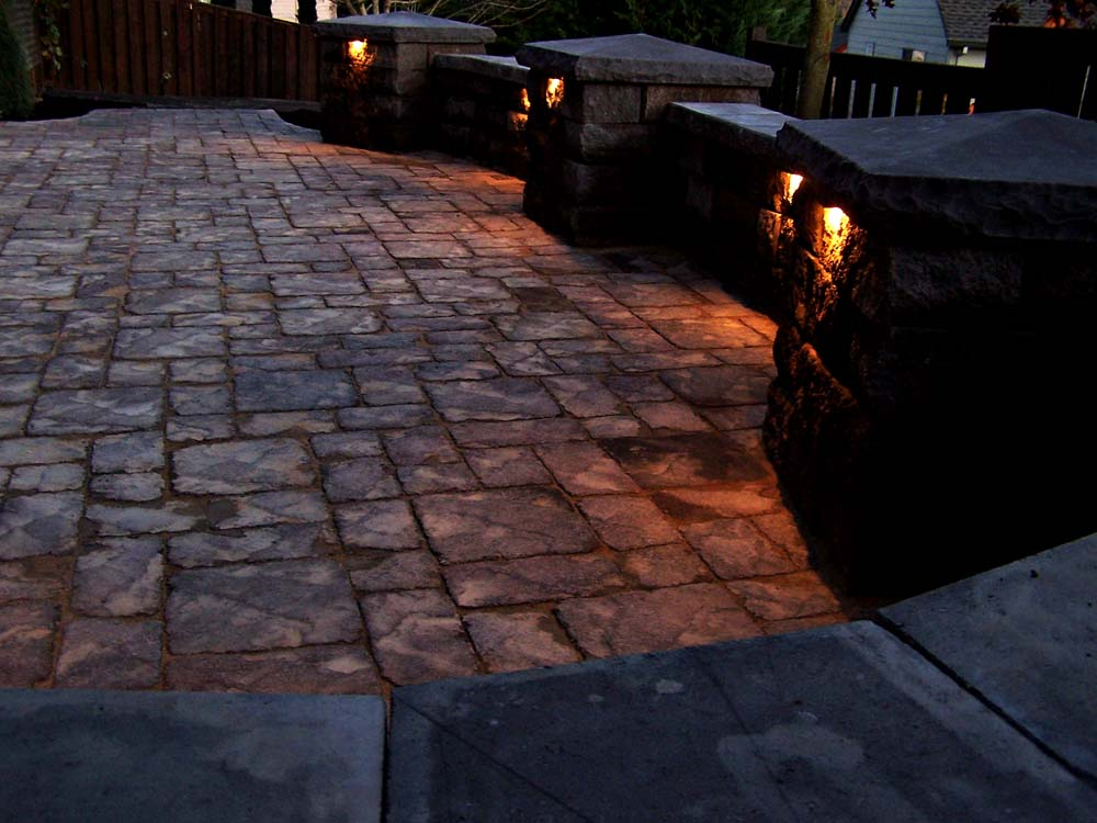 Seat-walls-courtyard-walls-columns-harmon-project-2008-walls-lit-up-custom-lighting 002