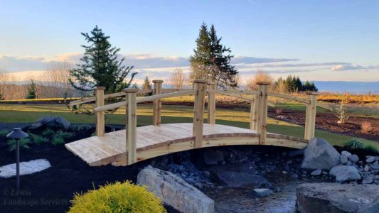 Close-up of Bridge at Top of Waterfall, New Sod Lawn, Planting