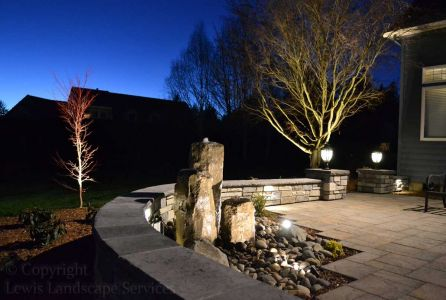 View of Patio & Water Feature at Night